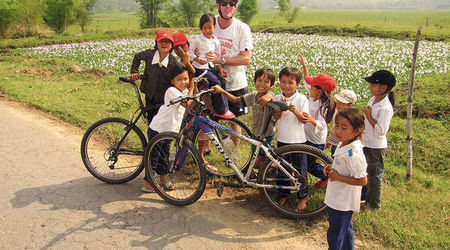 Cyclist With Children Near  Hue  Credit  Exodus