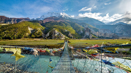 Suspension bridge with buddhist prayer flags Annapurna